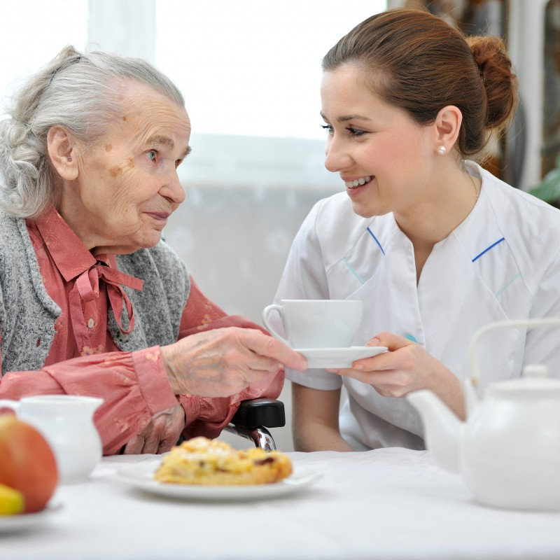 Senior woman eats lunch at retirement home - Caring Hearts Home Care